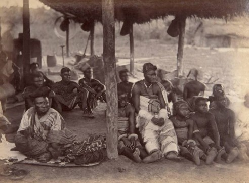 This picture taken c. 1889, possibly by G. F. Packer credited with other photos from the Niger and Önïcha (Onitsha) (and of Önïcha trading women), is annotated as 'Trader from Timbuctou' on the right and 'Rich Trading Woman' on the left.